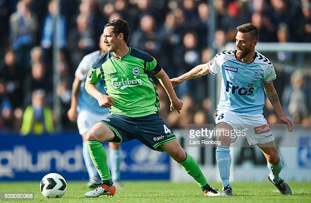 Hallgrimur Jonasson of OB Odense and Janus Drachmann of Sonderjyske compete for the ball during the Danish Alka Superliga match between Sonderjyske...