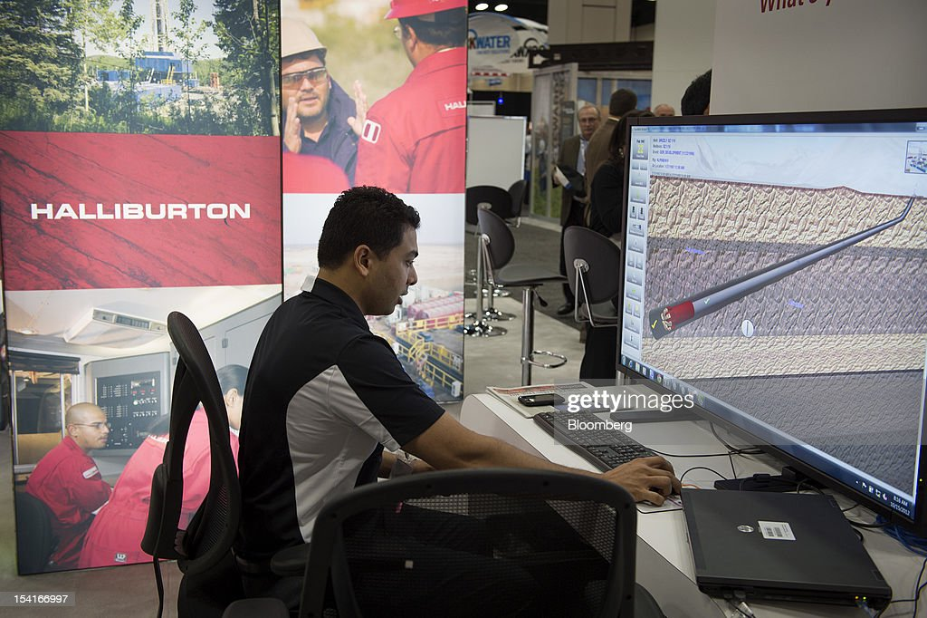 Halliburton Co. representative Narayan Shanke works with three dimensional well planning software at the company's booth at the DUG Eagle Ford Conference & Exhibition in San Antonio, Texas, U.S., on Monday, Oct. 15, 2012. Marathon Oil Corp., the U.S. oil and natural gas producer that spun off its refining business last year, is seeking to sell more than 96,000 net acres in the Eagle Ford formation in Texas. Photographer: Eddie Seal/Bloomberg via Getty Images