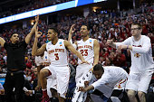 Hallice Cooke Jordan Ashton Simeon Carter and Stuart Nezlek of the Iowa State Cyclones celebrate from the bench in the second half against the...