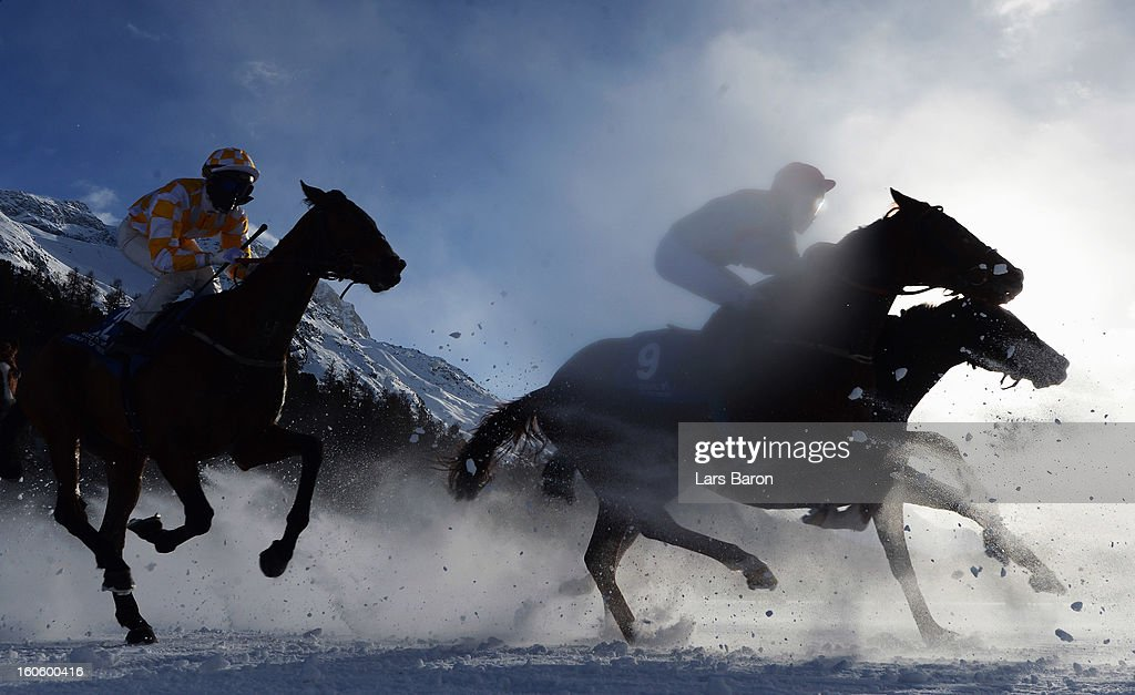 Halling River ridden by Robert Havlin (#9) competes during the Grand Prix Guardaval Immobilien race at the White Turf horse racing meeting held on the frozen Lake St Moritz on February 3, 2013 in St Moritz, Switzerland.