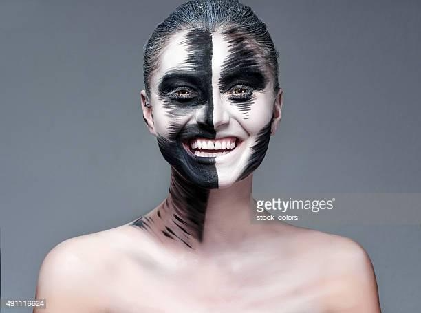 Halloween actress with makeup smiling