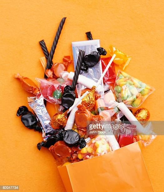 Halloween candy spilling from bag