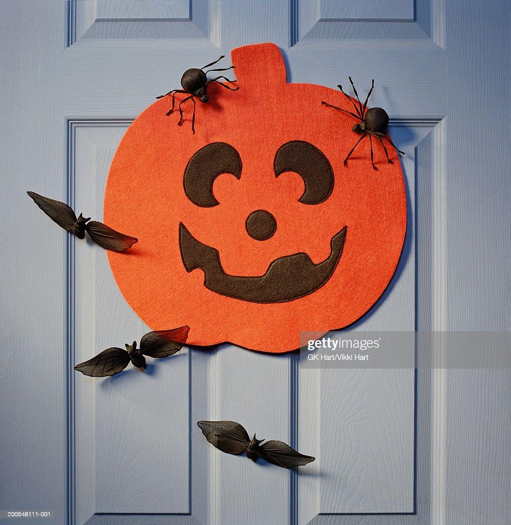 Halloween decorations hanging on front door : Stock Photo