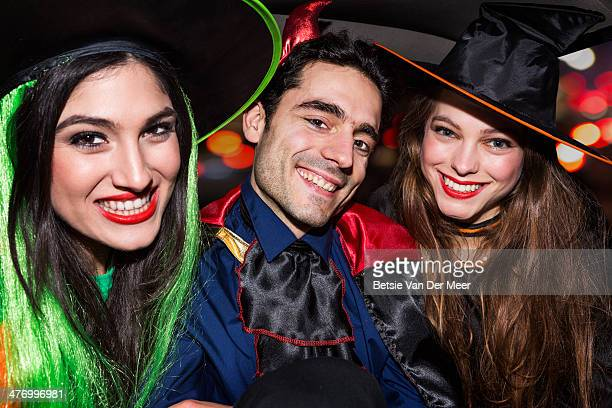halloween devil and witches in back of car.