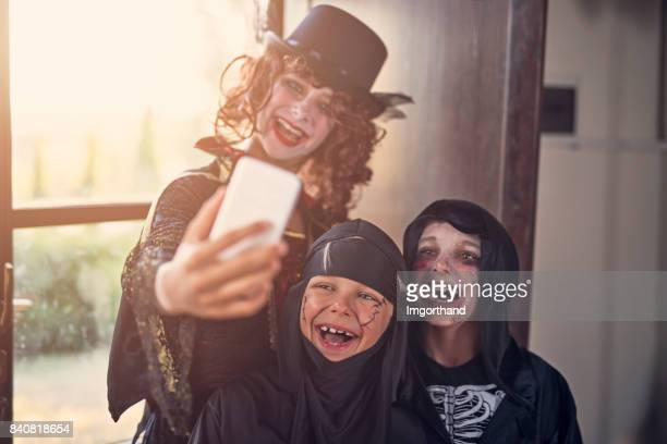 Halloween dressed up kinds making selfie