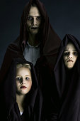 Father with two sons dressed up for Halloween as ghouls. See more my Halloween related photos: