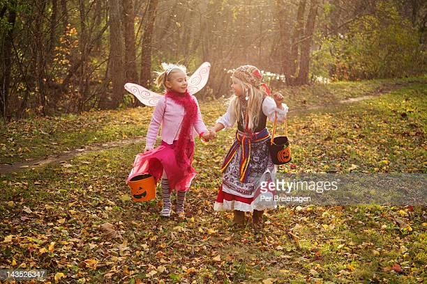 Halloween girls holding hands