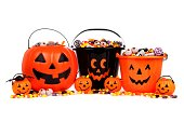 Group of assorted Halloween Jack o Lantern candy collectors isolated on a white background