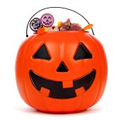 Halloween Jack o Lantern candy collector filled with candy over a white background