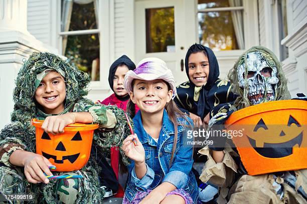 halloween kids on victorian house porch