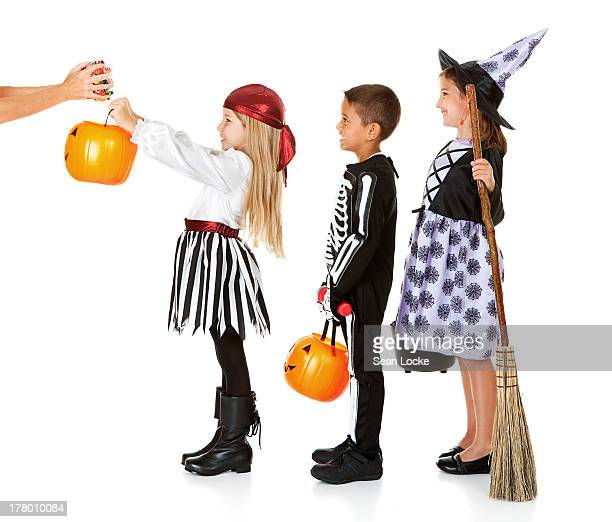Halloween: Kids Waiting for Trick or Treat Candy