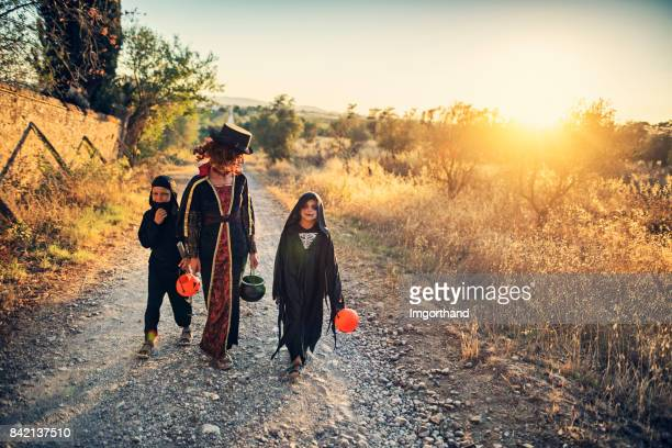 Halloween kids walking on dirt road