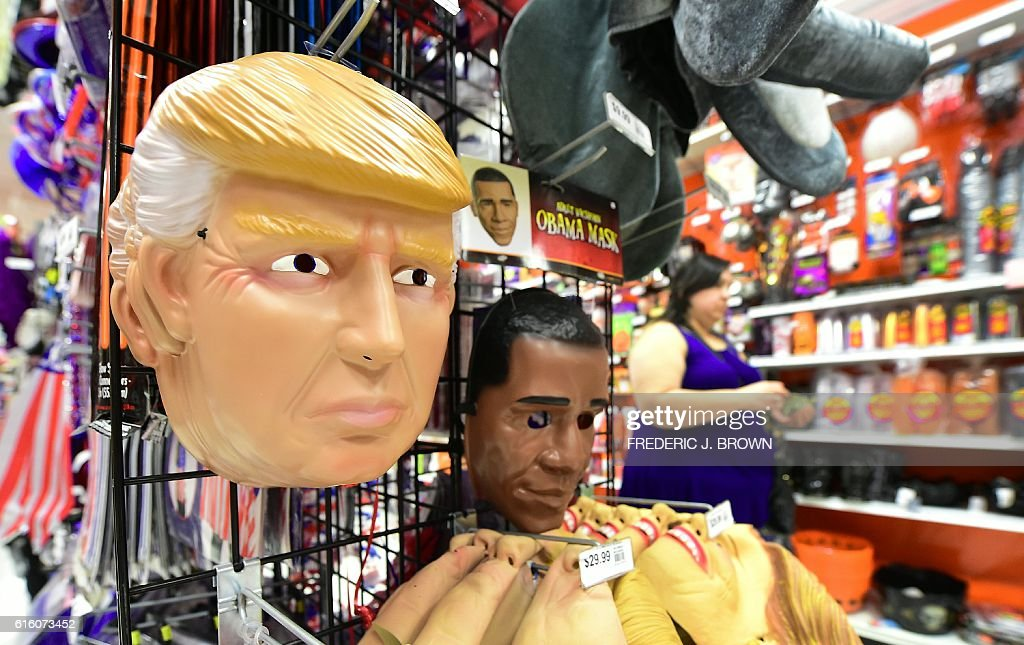 a halloween mask of presidential hopeful donald trump is displayed beside one of the us president barack obama as other presidential hopeful hillary - President Halloween Mask