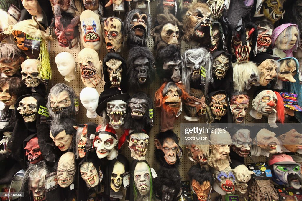 Halloween masks are offered for sale at Fantasy Costumes on October 28 2011 in Chicago Illinois The store which had long lines at the registers at 4...