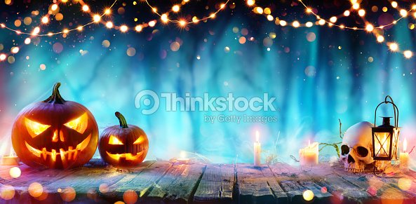 Halloween Party - Jack O' Lanterns And String Lights On Table In Misty Forest : Stock Photo