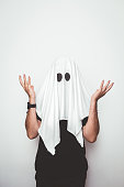 Man wearing ghost costume for halloween