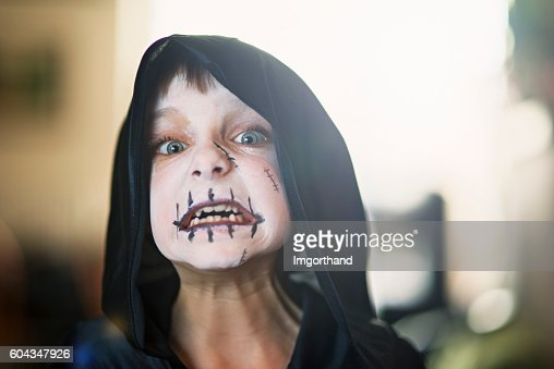 Halloween portrait of a little boy dressed up as monster