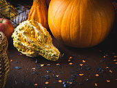 Halloween holiday still life background with squash and decorations