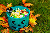 Halloween Party Favors for kids with food allergy. Teal pumpkin. the concept of health for children in the Halloween season