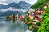 Hallstatt village in Alps at cloudy day, Austria