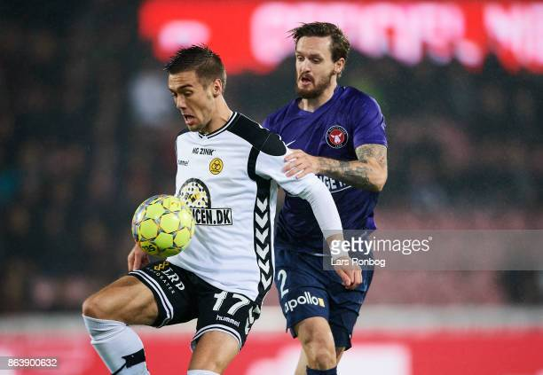 Hallur Hansson of AC Horsens and Kian Hansen of FC Midtjylland compete for the ball during the Danish Alka Superliga match between FC Midtjylland and...