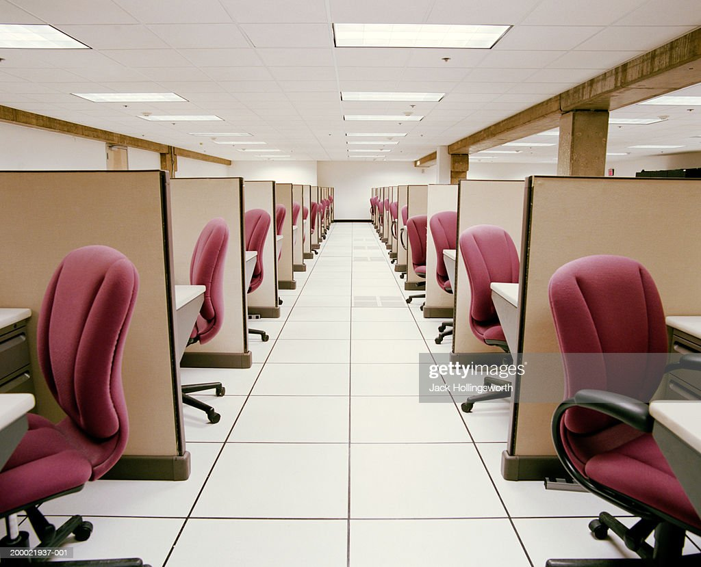Hallway between rows of empty cubicles : Stock Photo