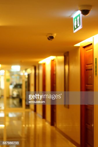 Apartment Building Hallway Lighting hallway of apartment building in yellow tungsten light stock photo