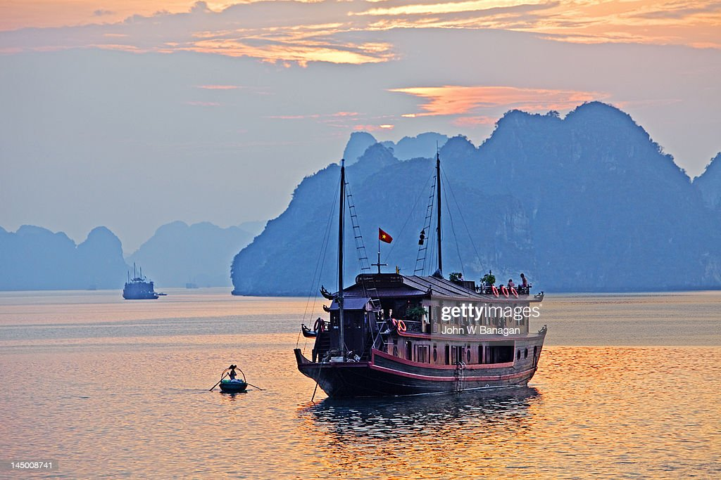 Halong Bay, boat at sunset , Vietnam : Stock Photo