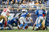 Haloti Ngata and Josh Bynes of the Detroit Lions force Blaine Gabbert of the San Francisco 49ers to fumble the ball during the game at Ford Field on...
