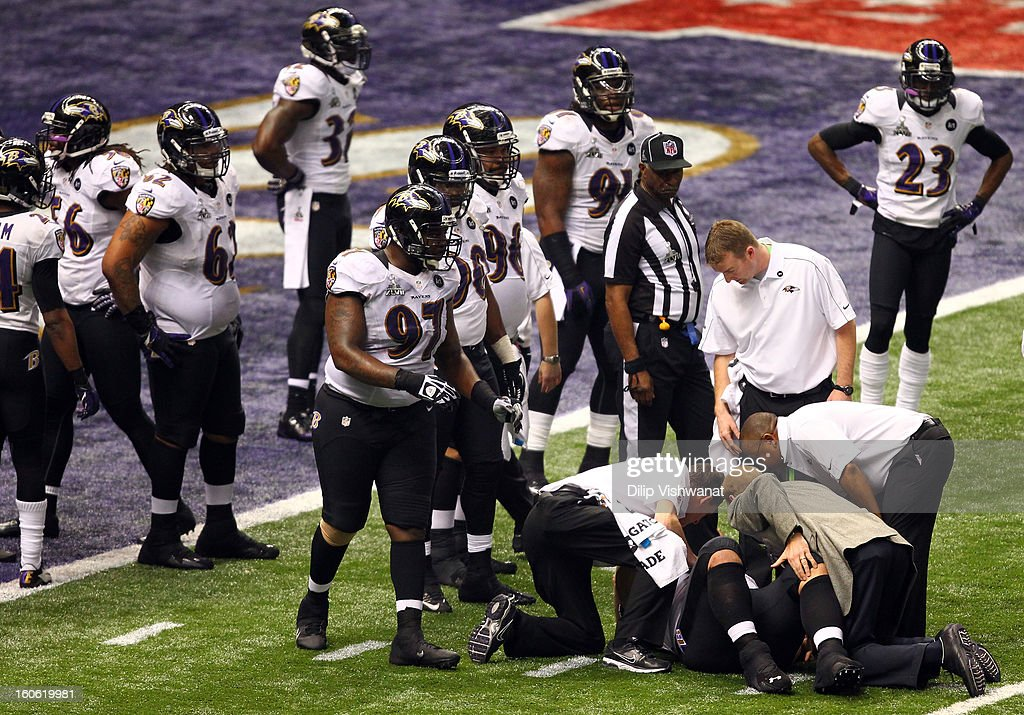 Haloti Ngata #92 of the Baltimore Ravens lays on the ground with a possible injury surrounded by his team during the second half against the San Francisco 49ers during Super Bowl XLVII at the Mercedes-Benz Superdome on February 3, 2013 in New Orleans, Louisiana.
