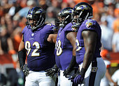Haloti Ngata of the Baltimore Ravens left looks on in between plays during the second half against the Cleveland Browns at FirstEnergy Stadium on...