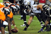 Haloti Ngata of the Baltimore Ravens lines up for a play during the fourth quarter of the game against the Denver Broncos at Sports Authority Field...