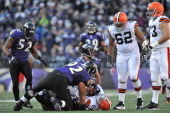 Haloti Ngata of the Baltimore Ravens sacks Seneca Wallace of the Cleveland Browns at MT Bank Stadium on December 24 2011 in Baltimore Maryland The...