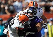 Haloti Ngata of the Baltimore Ravens tackles Terrance West of the Cleveland Browns during their game at FirstEnergy Stadium on September 21 2014 in...