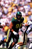 Haloti Ngata of the Oregon Ducks runs against the Idaho Vandals on September 14 2002