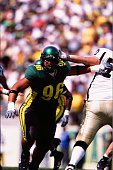 Haloti Ngata of the Oregon Ducks sheds a blocker against the Idaho Vandals on September 14 2002