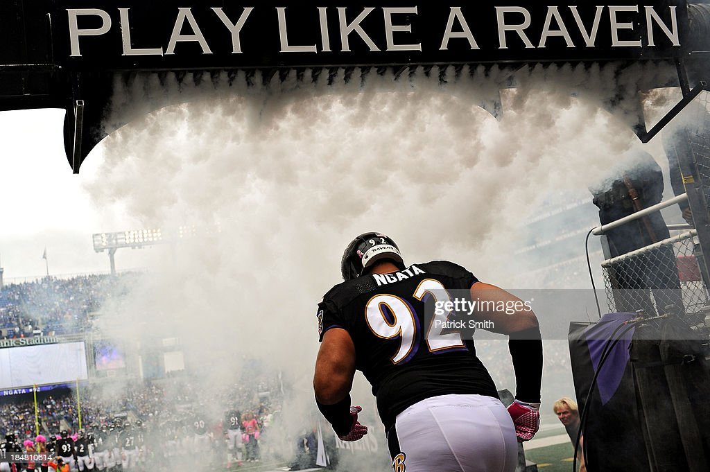 <a gi-track='captionPersonalityLinkClicked' href=/galleries/search?phrase=Haloti+Ngata&family=editorial&specificpeople=622374 ng-click='$event.stopPropagation()'>Haloti Ngata</a> runs through smoke as he is introduced before playing the Green Bay Packers at M&T Bank Stadium on October 13, 2013 in Baltimore, Maryland.