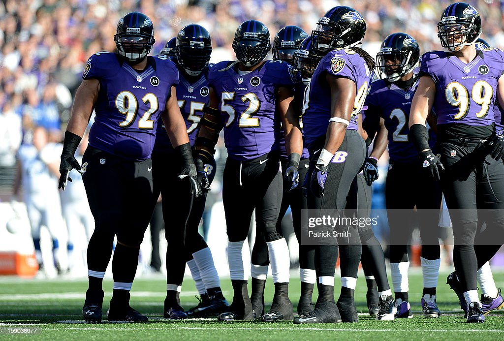 Haloti Ngata #92, Terrell Suggs #55, Ray Lewis #52, Ma'ake Kemoeatu #96 and Paul Kruger #99 of the Baltimore Ravens look on against the Indianapolis Colts during the AFC Wild Card Playoff Game at M&T Bank Stadium on January 6, 2013 in Baltimore, Maryland.