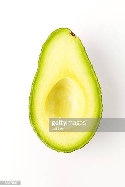 Halved avocado with stone removed
