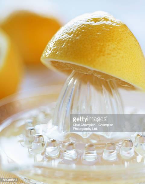 Halved lemon on glass juicer