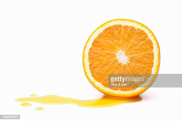 Halved orange with juice