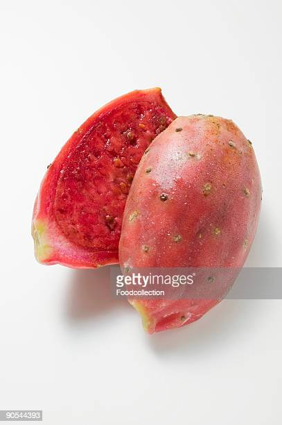Halved prickly pear on white background, close up