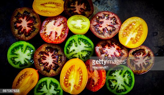 Halves of different coloured tomatoes