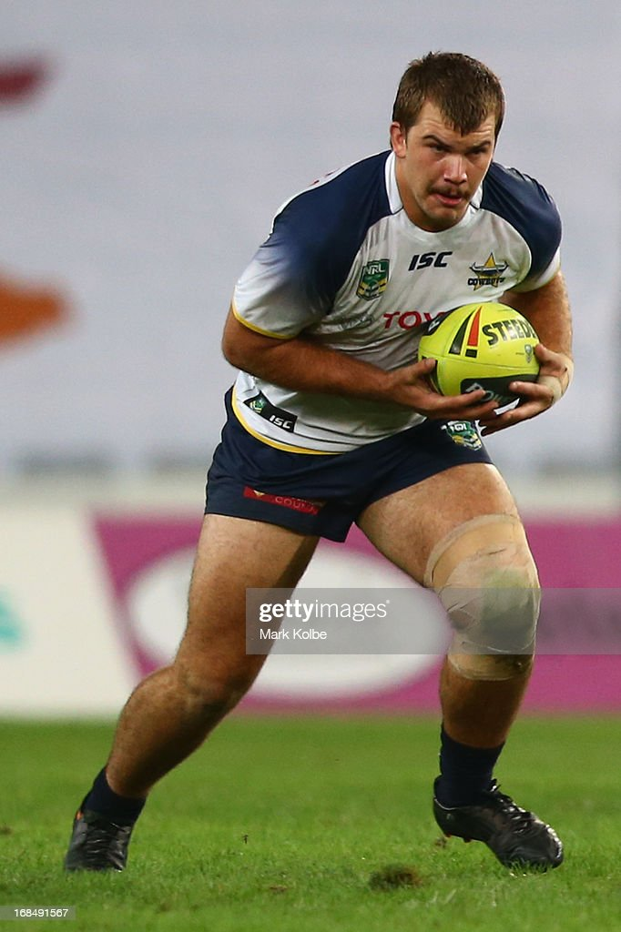 Halvor Harris of the Cowboys runs the ball during the round nine Holden Cup match between the South Sydney Rabbitohs and the North Queensland Cowboys at ANZ Stadium on May 10, 2013 in Sydney, Australia.