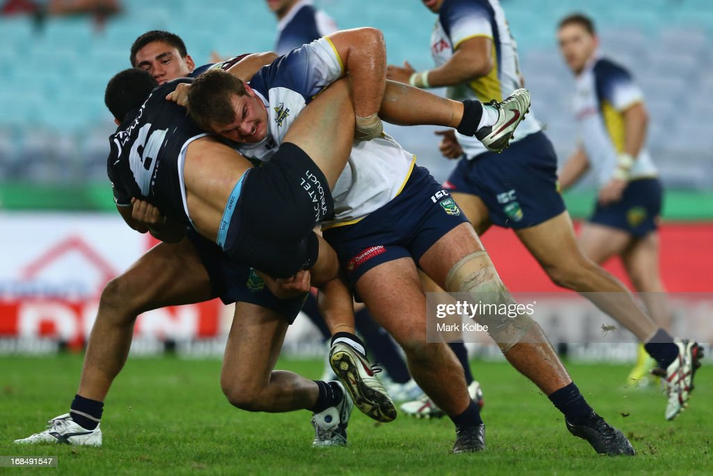 Halvor Harris of the Cowboys tackles Mitchell Grimes of the Rabbitohs during the round nine Holden Cup match between the South Sydney Rabbitohs and the North Queensland Cowboys at ANZ Stadium on May 10, 2013 in Sydney, Australia.