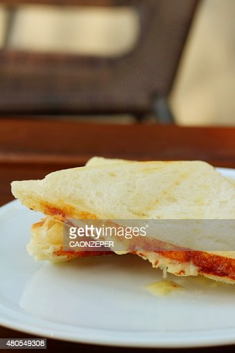 Ham and cheese sandwich on a white plate. : Stock Photo