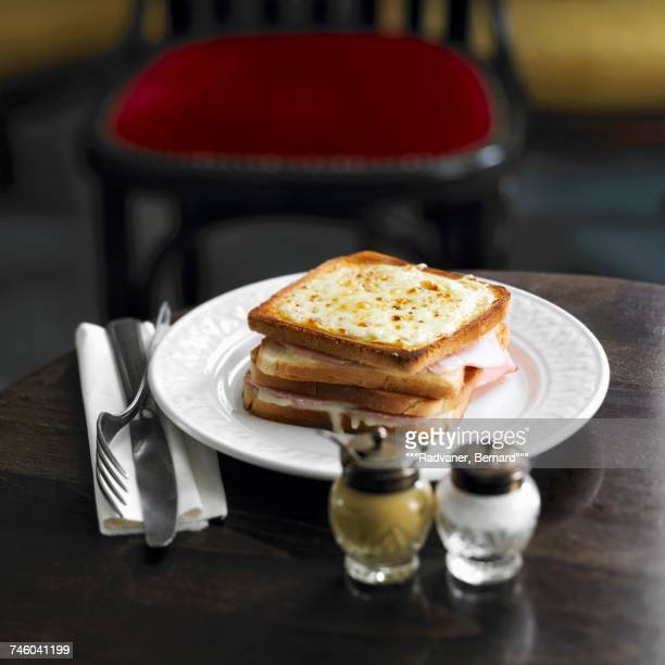 Ham and cheese toasted sandwich topped with grilled cheese