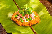 Ham and peas on a potato cake