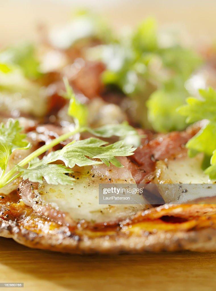 Ham and Salami Pizza with Fresh Cilantro : Stock Photo