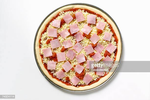 Ham, cheese and tomato pizza (unbaked)
